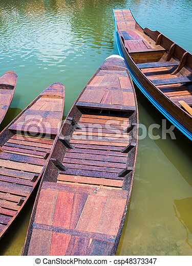 Wooden boat float in lake - csp48373347
