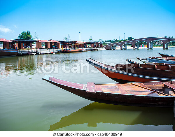 Wooden boat float in lake - csp48488949