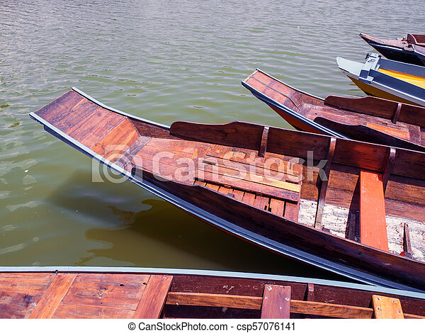 Wooden boat float in lake - csp57076141