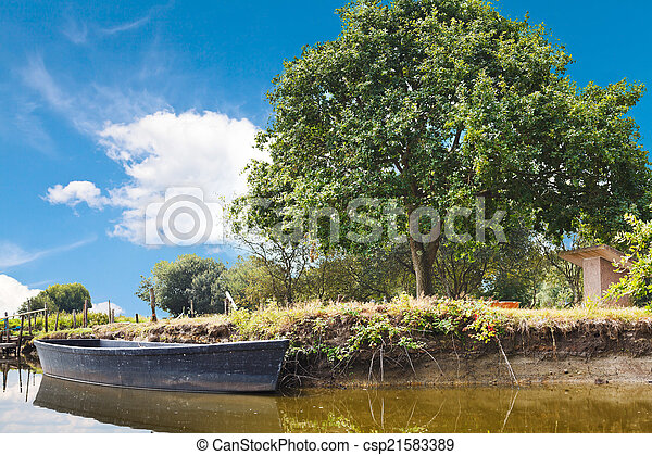 wooden boat in lake, France - csp21583389