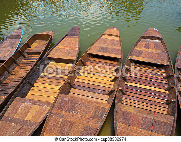 Wooden boat in lake - csp38382974