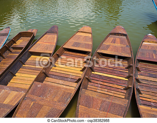 Wooden boat in lake - csp38382988