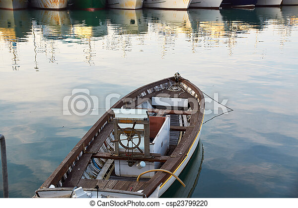 Wooden boat vintage type on offshore berth - csp23799220