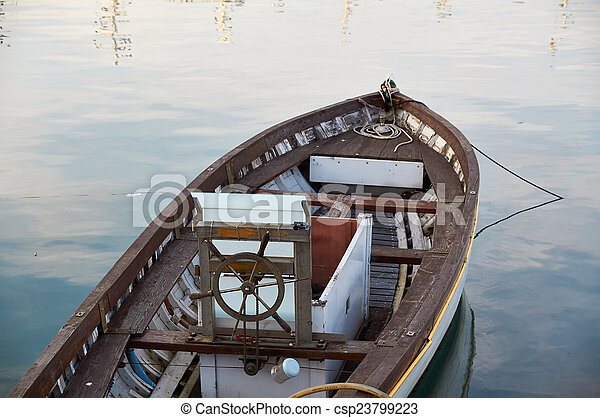 Wooden boat vintage type on offshore berth - csp23799223