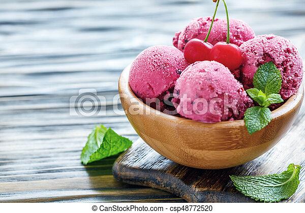 Wooden bowl with cherry ice cream. - csp48772520