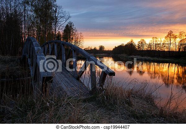 Wooden bridge on river - csp19944407