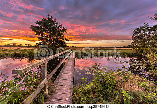 Wooden bridge sunset - csp38748612