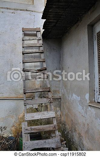 wooden broken ladder - csp11915802
