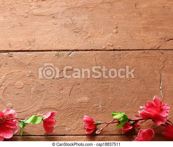 wooden brown background with flower - csp18837511