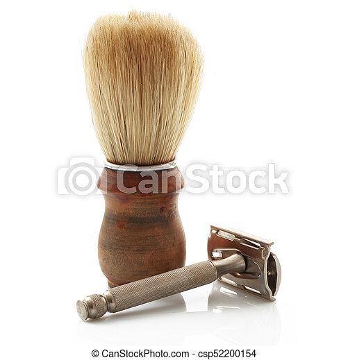 wooden brush with razor on white background - csp52200154