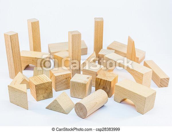 Wooden building blocks on white background - csp28383999