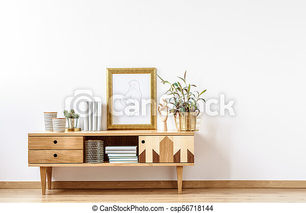 Wooden cabinet by empty wall - csp56718144