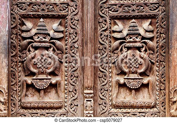 Hindu temple wooden carved door detail, bhaktapur, nepal.