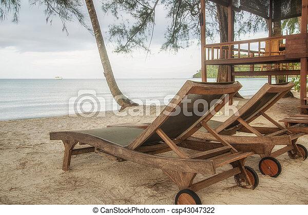 wooden chair at beach - csp43047322