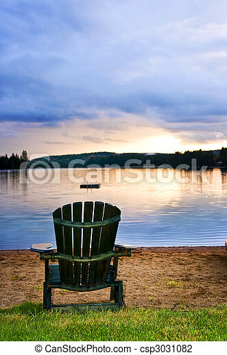 Wooden chair at sunset on beach - csp3031082