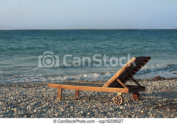 Wooden chair on the beach - csp16239527