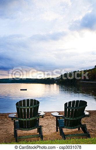 Wooden chairs at sunset on beach - csp3031078