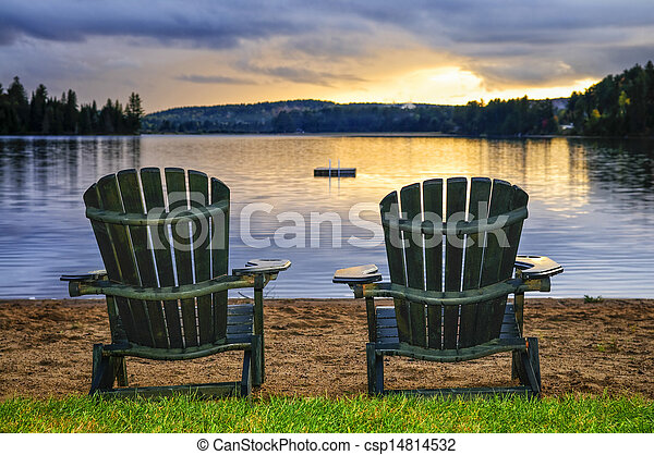 Wooden chairs at sunset on beach - csp14814532