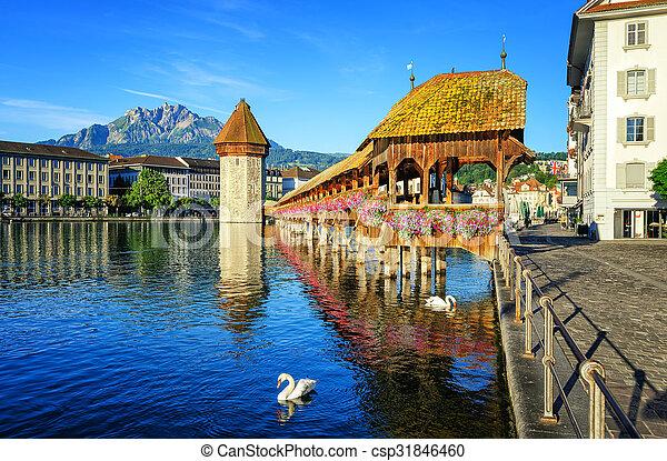 Wooden Chapel Bridge and Water Tower int Lucerne, Switzerland - csp31846460