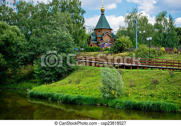wooden chapel on the shore of a river - csp23818527