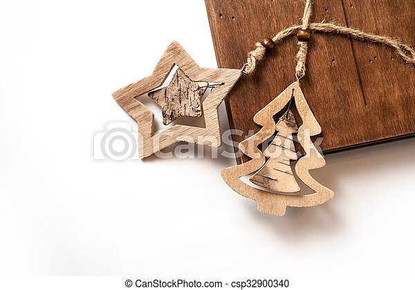 Wooden Christmas toys on a white background with place for text - csp32900340