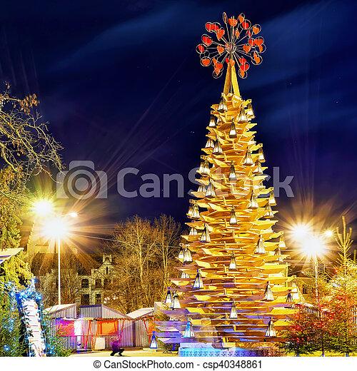 Wooden Christmas Tree And The Market At Night In Riga Riga Latvia