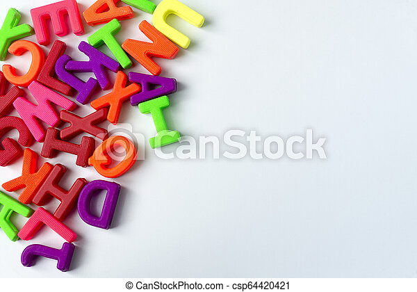 Wooden colored letters on a white background. - csp64420421