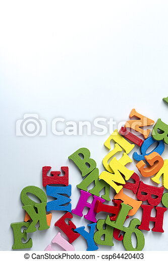 Wooden colored letters on a white background. - csp64420403