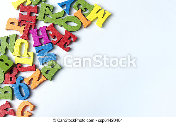Wooden colored letters on a white background. - csp64420404