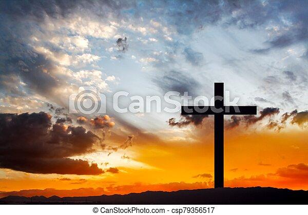 Wooden cross against sky backgroun - csp79356517
