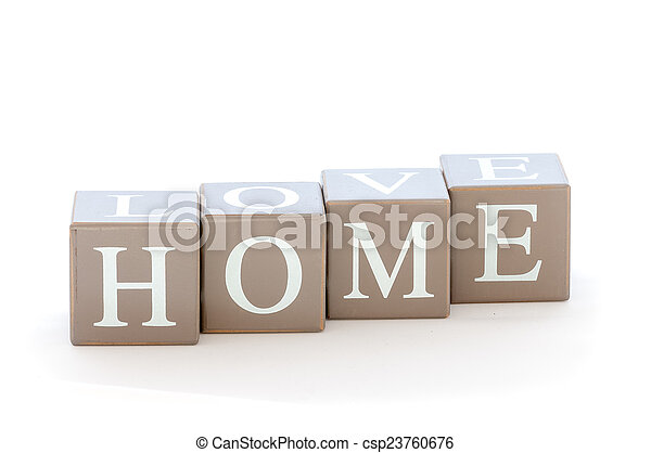 Wooden cubes wit the word home spelled - csp23760676