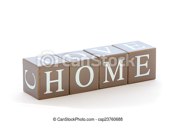Wooden cubes wit the word home spelled - csp23760688