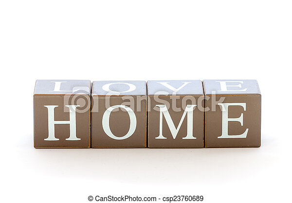 Wooden cubes wit the word home spelled - csp23760689