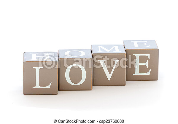 Wooden cubes wit the word love spelled - csp23760680
