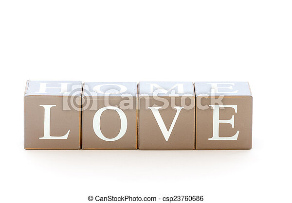 Wooden cubes wit the word love spelled - csp23760686