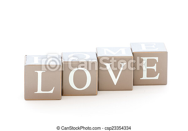 Wooden cubes wit the word love - csp23354334