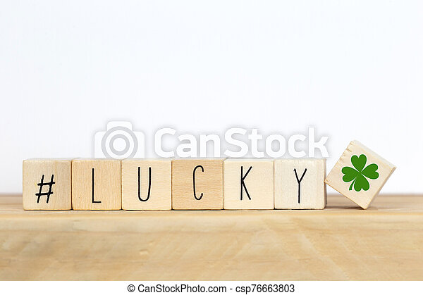Wooden cubes with a hashtag and the word lucky background, social media concept - csp76663803