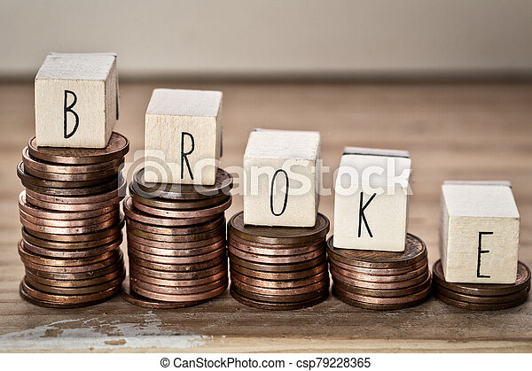 Wooden cubes with the word broke and pile of coins, money climbing stairs, business concept - csp79228365