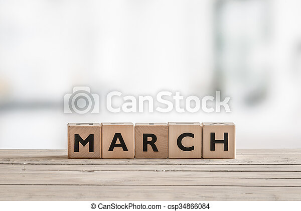 Wooden cubes with the word march - csp34866084