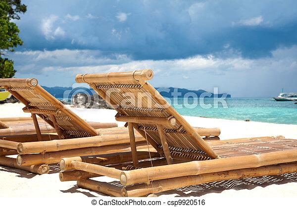 Wooden deck chairs on beach - csp9920516