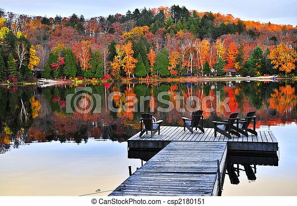 Wooden dock on autumn lake - csp2180151