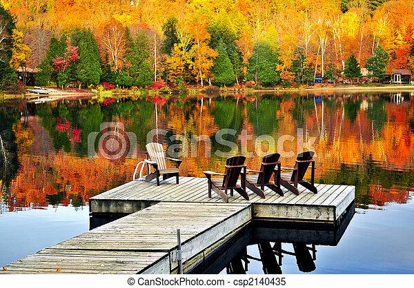 Wooden dock on autumn lake - csp2140435