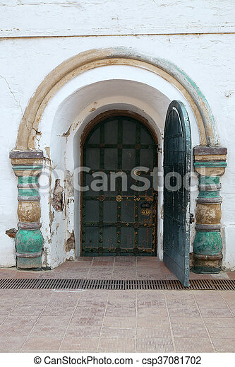 Wooden door and wall with ornament - csp37081702