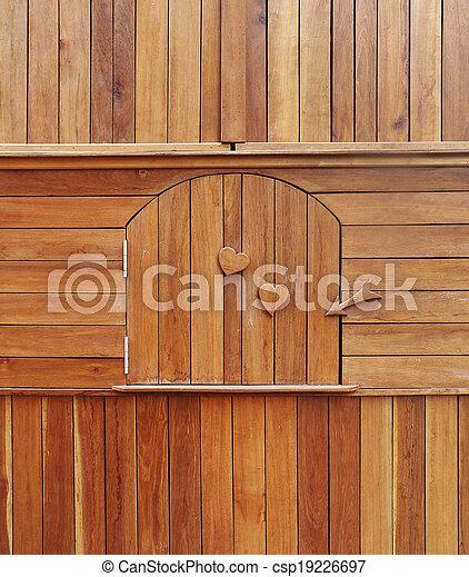 wooden door in wooden cabinet - csp19226697