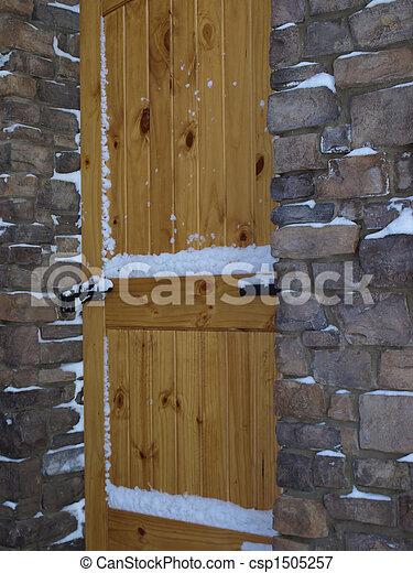 Wooden door, stone entry