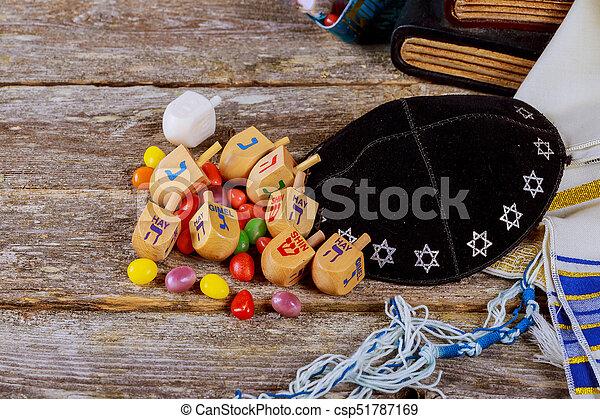 wooden dreidels spinning top for hanukkah jewish holiday - csp51787169