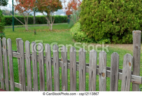 wooden fance and background from green garden - csp12113867