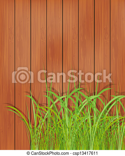 Wooden fence and green grass - csp13417611