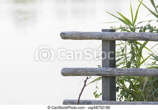 wooden fence at lake - csp58752186