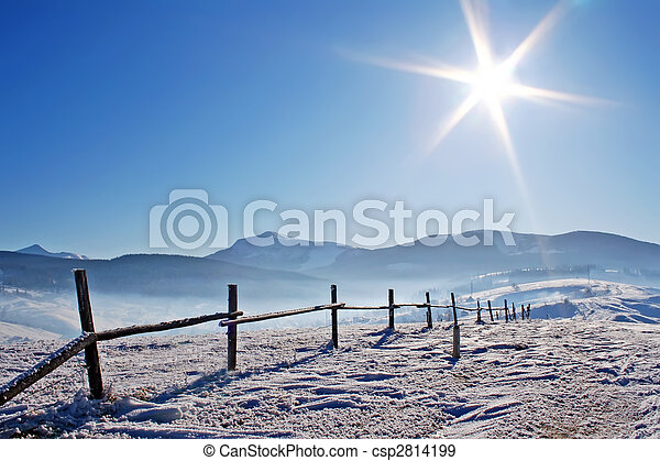 Wooden fence in snowcovered mountains - csp2814199